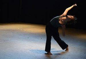 Julie Crothers dancing on stage.  Click link to magnify and go to image source.